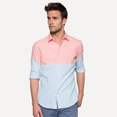 While I am not a fan of this particular shirt; it does show how a change of color on the top half of the shirt can give the appearance of broader shoulders.