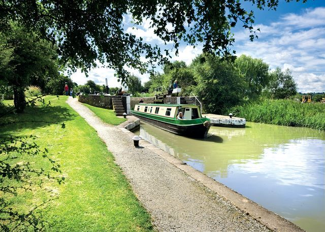 One of our fleet of holiday hire boats emerging from the bottom lock at Calcutt, on a cruise towards Warwick and Stratford-on-Avon #narrowboat #canal #holiday www.calcuttboats.com