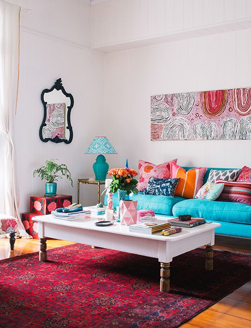 ADORE_BRISBANE magazine. turquoise/teal sofa. pink and orange accents. love how colorful this living room is