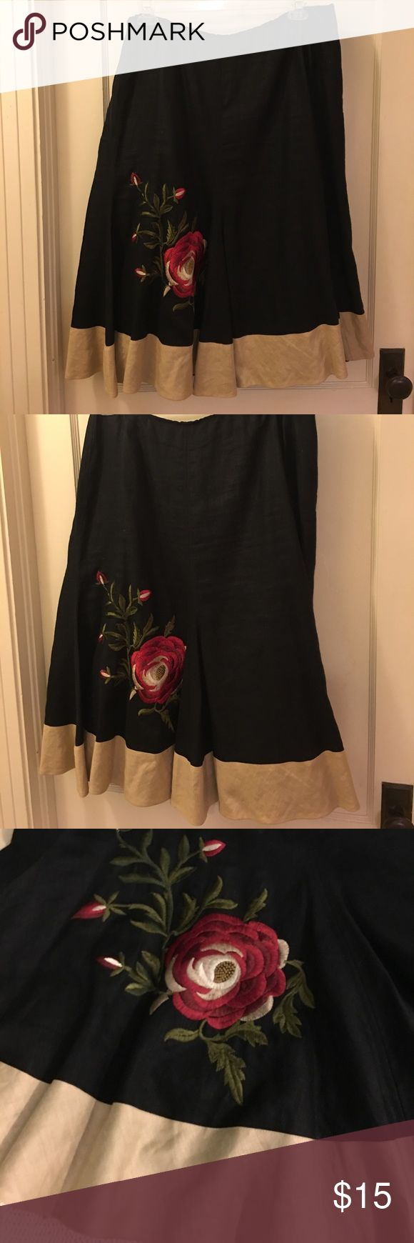 Cotton/linen lined skirt Cotton linen lined skirt with border and lovely embroidered flower on the skirt. Casual wear for work, party or church. Can be dressed up or down. Nine West Skirts