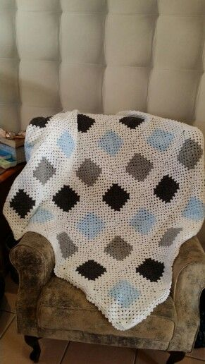 Crochrted Granny square blanket in blue grey and white