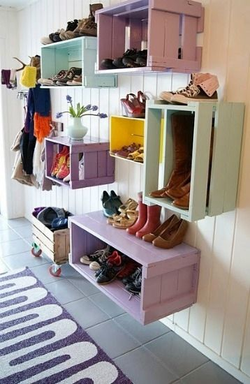 Nail cajas pintadas en la pared de colorido estanterías. | 41 Clever Organizational Ideas For Your Child's Playroom