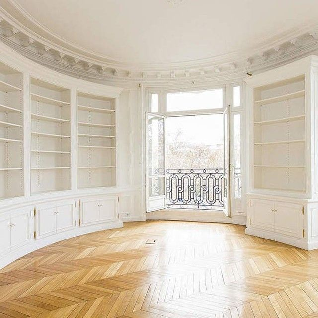 I want built-in shelves kind of like these (maybe minus the bottom cabinets) in a hallway to serve as a library. Ooh! And a rolling ladder!