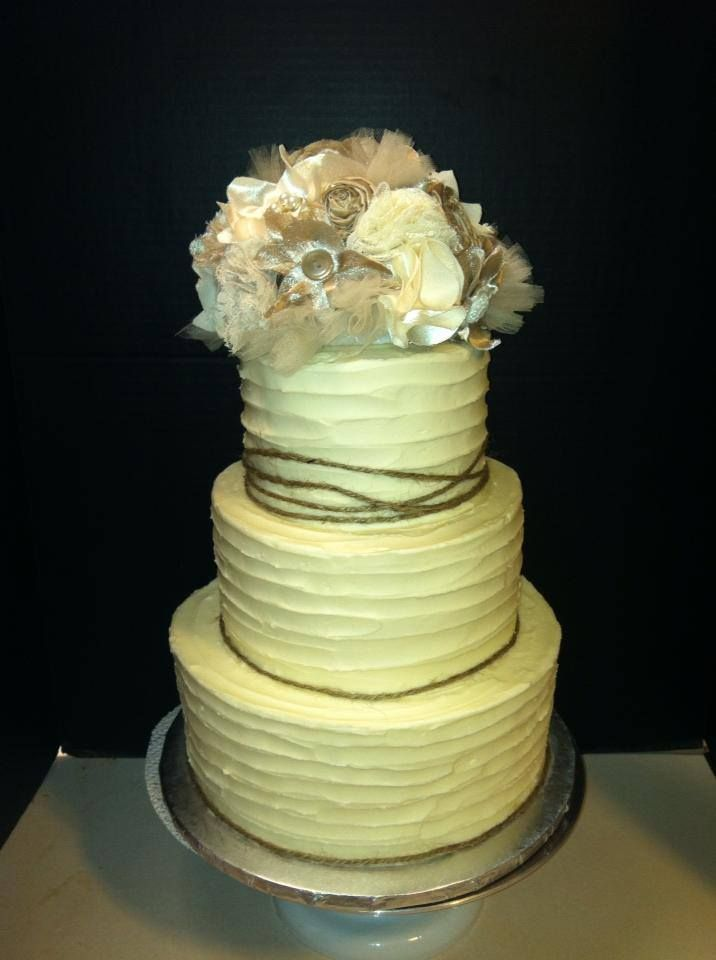 3 tier round wedding cake, rustic themed, twine and flowers ...