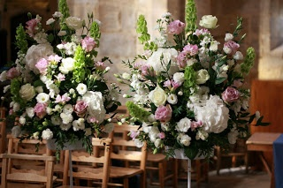Avalanche Roses, Freesia and Ruscus in simple and elegant design