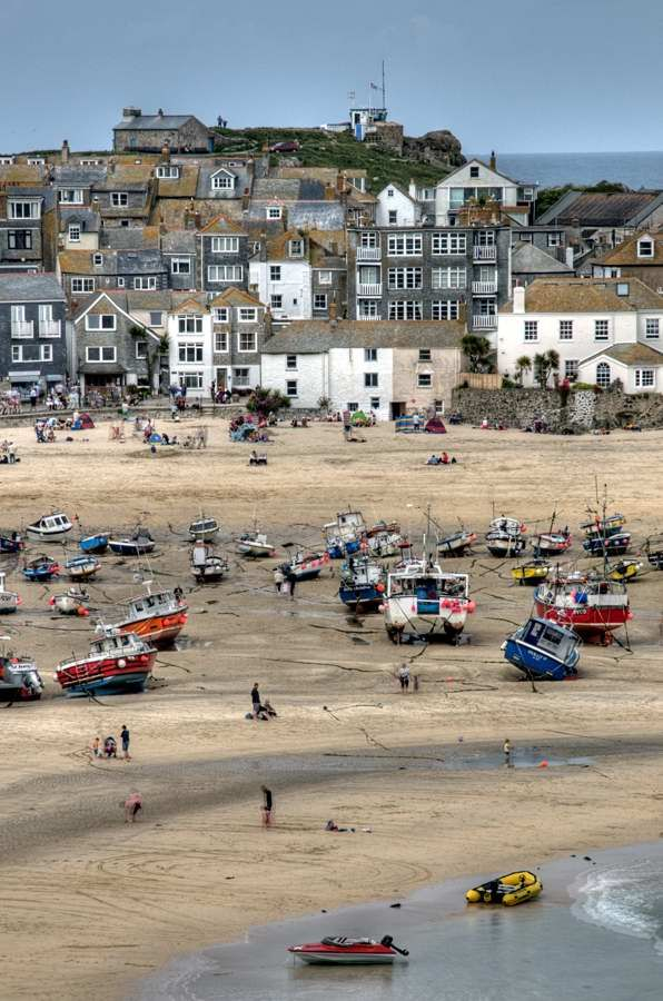 Harbour Beach at St Ives, Cornwall.  It's very popular now and bits best to get a train as car parking is very limited and the roads through are narrow.