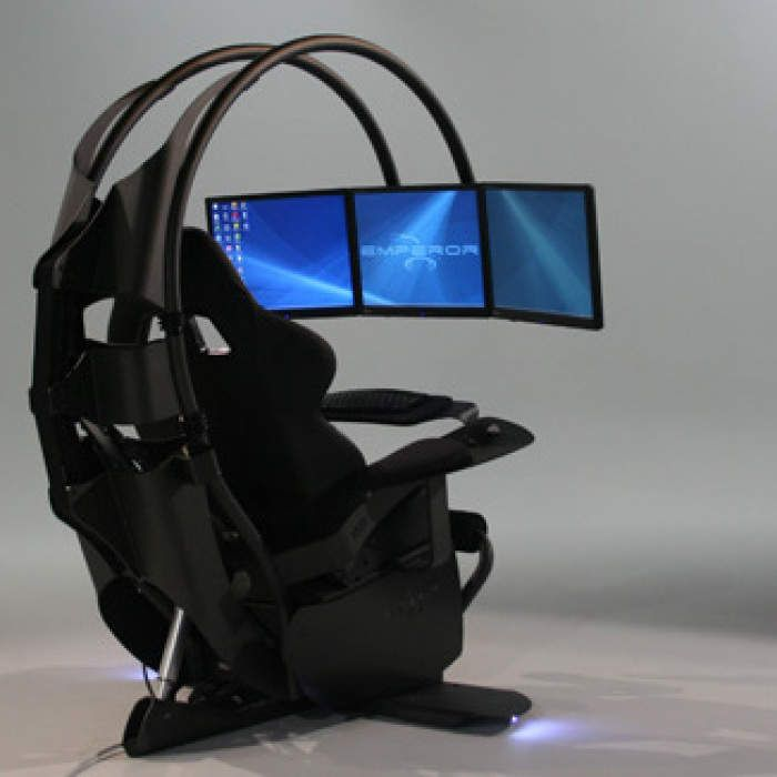 It may be shaped like a scorpion tail, but your computer will be rocking you like a hurricane once you connect it to MWE's more affordable version of their $50k game & workstation, supporting a trio of computer monitors and boasting glare-reducing LED lighting, a Bose surround-sound system, and a reclining chair with everything from USB inputs to an in-seat sub-woofer.