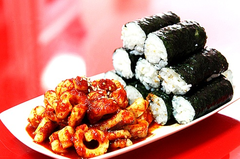 Chungmu Gimbap(충무김밥) is made with only rice and served with squid muchim(오징어 무침) and diced radish.