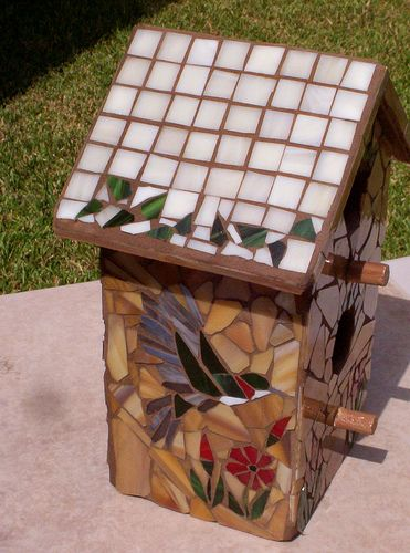 Other side of same birdhouse.  This is a great house warming gift.  I made some for a realtor and builder so when they sold a house they would give one to the new homeowner and everytime they looked at it or showed it, they thought of the giver and what a wonderful feeling that is!  If interested, email me via my website: www.mosaicsbymarlene.com