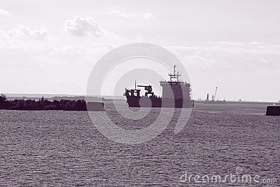 Merchant ship in the waters of Kronshtadt autumn sunny day. Saint-Petersburg, Russia