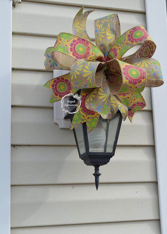 I love these colors. New! Easter Basket Bow Easter Decor. Spring Swag Bow. Mailbox topper. Floral ribbons with yellow, pink, and blue on a tan background that mimics the look of burlap. Floral arrangement bow, centerpiece bow, outdoor spring bow, indoor decor, summer decor, summer bow.