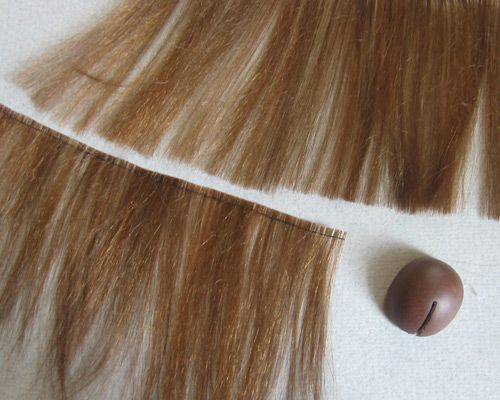Russian site with some fantastic doll wig-making ideas & tutorials.