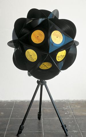 Sean Duffy, Burn Out Sun, 2003. 20 LP records, glue, metal tripod, 42 x 33 x 33 inches. Collection of Debra and Dennis Scholl, Miami Beach. Courtesy of the artist and Susanne Vielmetter Los Angeles Projects. Photo by Gene Ogami