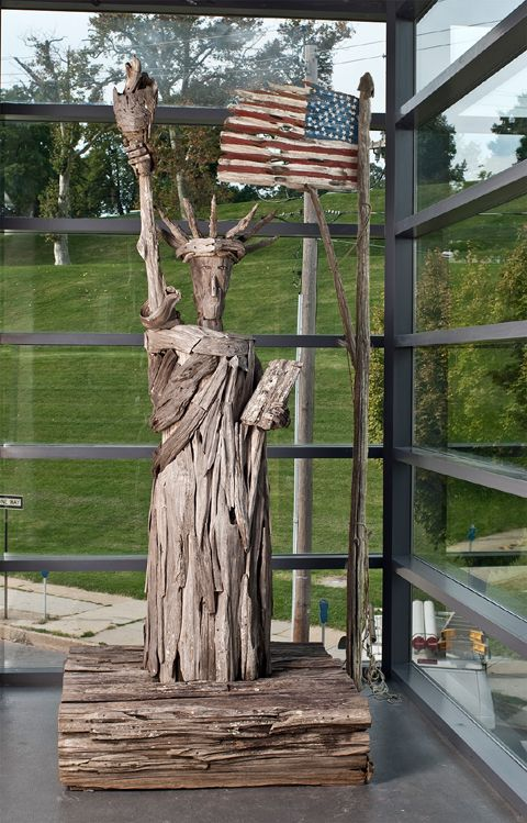 Statue of Liberty and the Star Spangled Banner by Adam Morales. 1999. Driftwood and Paint. Photo: Dan Meyers.