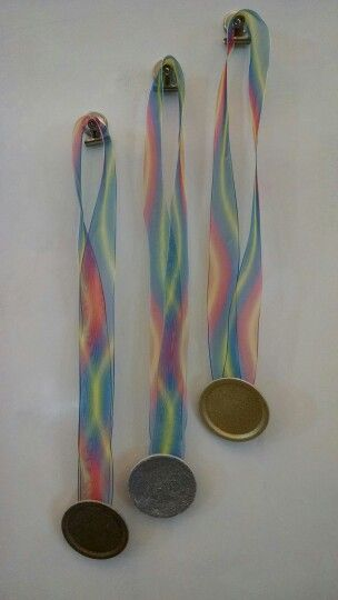 Mason Jar Lid Olympic Medals- glitter spray paint with a ribbon hot glue gunned to the back!