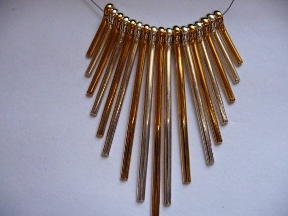 Buy Gold and silver, plated, fan finding, 17 pieces, 20 to 59mm long, Pkg Of 1 by darsjewelrysupplies. Explore more products on http://darsjewelrysupplies.etsy.com