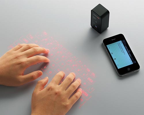 Elecom Projection Bluetooth Keyboard. This laser keyboard features an ultra portable design, and the built-in projector is able to project a large red keyboard on any flat surface in order to offer you a more comfortable typing experience than typing on a small screen, and the brightness and sound of the virtual wireless keyboard are adjustable.