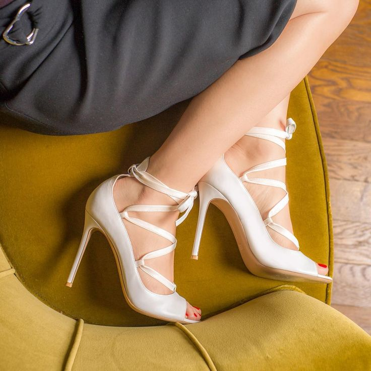 """""""Wrap sandals will still be big this summer. Invest in a white leather pair."""""""