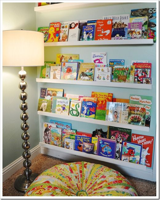 Showing the fronts of all your books inspires kids to read.  I also want to make that floor cushion in boy colors.