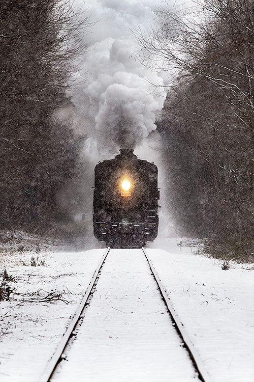 Essex Steam Train passing through Deep River, Connecticut during a snowstorm.