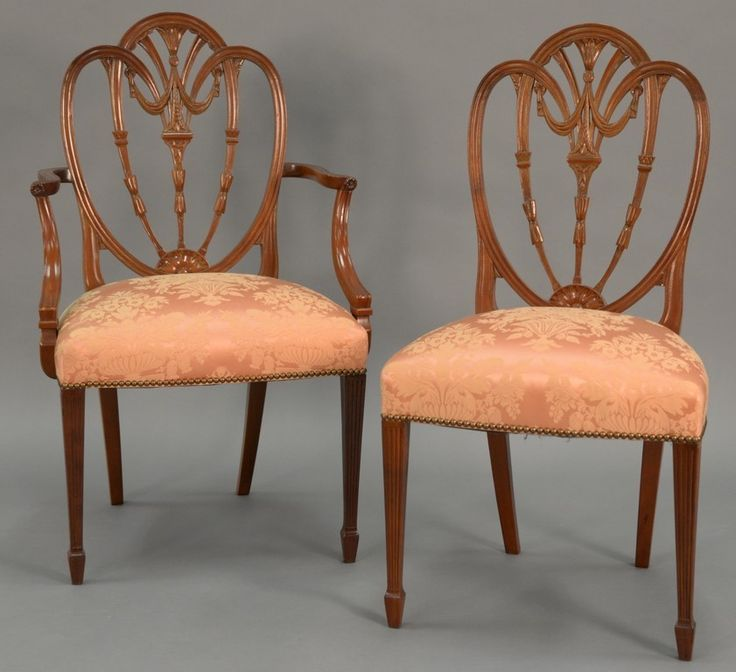 Margolis set of ten Federal style dining chairs including two armchairs and eight side chairs with carved open work heart shaped backs and fully upholstered silk seats, all set on fluted square tapered legs. ht. 40in. ~ Realized Price $4,200.