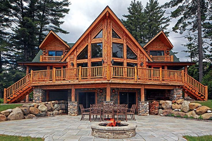 Read more about this couple's New York log home retreat located on a 3/4 acre lot by a lake.