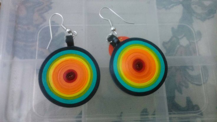 Rainbow dangle earrings - These earrings were created using the technique of paper quilling. It is varnished well so it doesn't get wet. Goes really well with plain white or black, tops and tees. This will also add an extra splash to your cocktail dress.  It will be a great gift for your friend or your sister. Can ping me here to order the same.