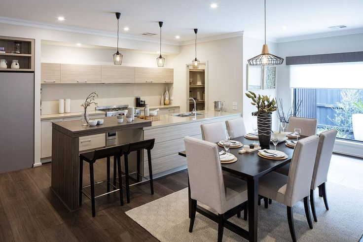 This charming open plan living area seamlessly connects the dining and kitchen areas. #weeksbuildinggroup #homedesign #interiordesign #newhome