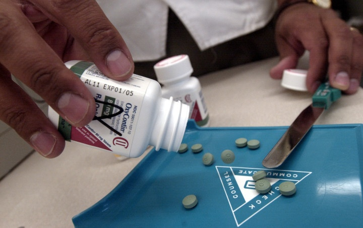 One company, two drugs, two takes on pill safety