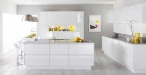 Modern white kitchen with island and bar - love the yellow accents! #kitchens #revitalizeandredesign