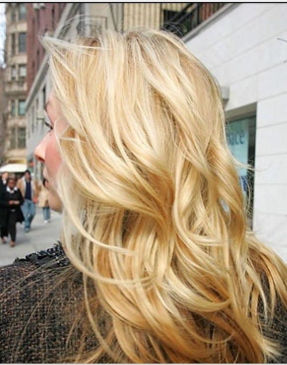 Long, blonde hair with layers.