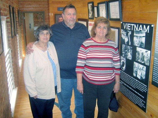 "W.A. ""Billy"" Robinson is joined by his sisters Ginger Hux (left) and Jackie Robertson during a visit to the Roanoke Canal Museum. Robinson has committed to return to the museum in May 2014 for a program focusing on his experience as a POW in Vietnam."
