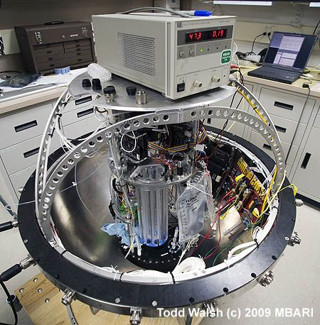 When most people think of robots, they think of mobile machines that look vaguely like people. This photograph shows a real 21st century robot that can perform DNA analyses 4,000 meters below the ocean surface. This complex machine is called the deep Environmental Sample Processor (D-ESP).