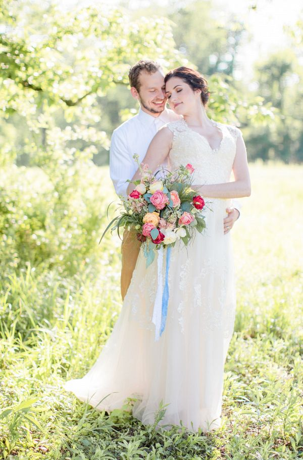 Bride and groom in field    #wedding #weddingday #aislesociety