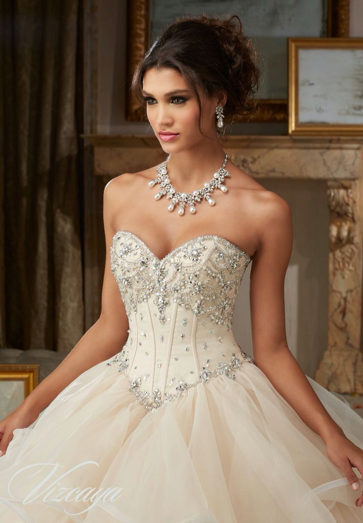 Morilee Vizcaya Quinceanera Dress 89107 JEWELED BEADING ON FLOUNCED ORGANZA BALL GOWN  Matching Bolero Jacket. Available in Champagne, Iced Pink, White (Color of this dress): Champagne