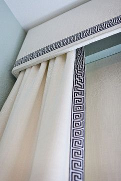 Creative ways to extend the length of your curtain panels: lengthen from the top and hide behind decorative cornice like this one with matching trim on the bottom.