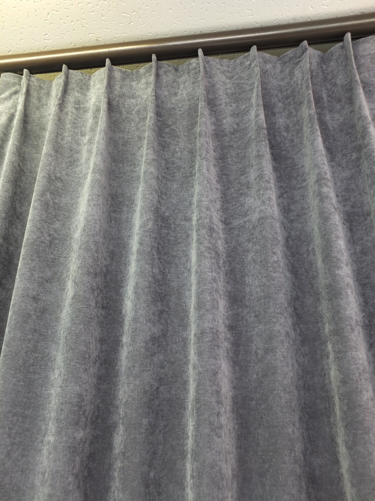 Scotch pleat heading style for curtains.