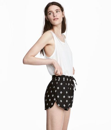 Black/patterned. Short shorts in woven fabric with an elasticized drawstring waistband and short slits at sides.