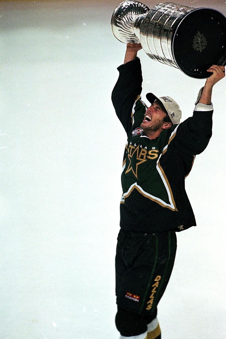 Mike Modano hoisting the Stanley Cup 6/20/1999