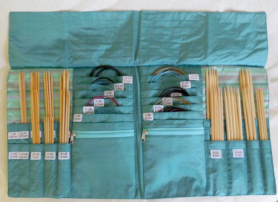 Della Q DPN and Circular Needle Case redesigned to hold one complete set of DPNs and multiple sets of circulars. A quad-fold design securely holds your needles with fourteen numbered DPN slots and twelve labeled circular needle pockets all in this combination knitting needle case. There are