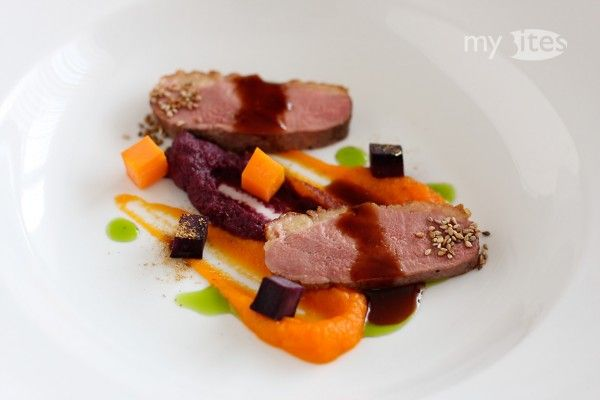 Duck Breast with Purple and Orange Carrot Puree, Basil Oil, Sesame Seeds and Cep Dust