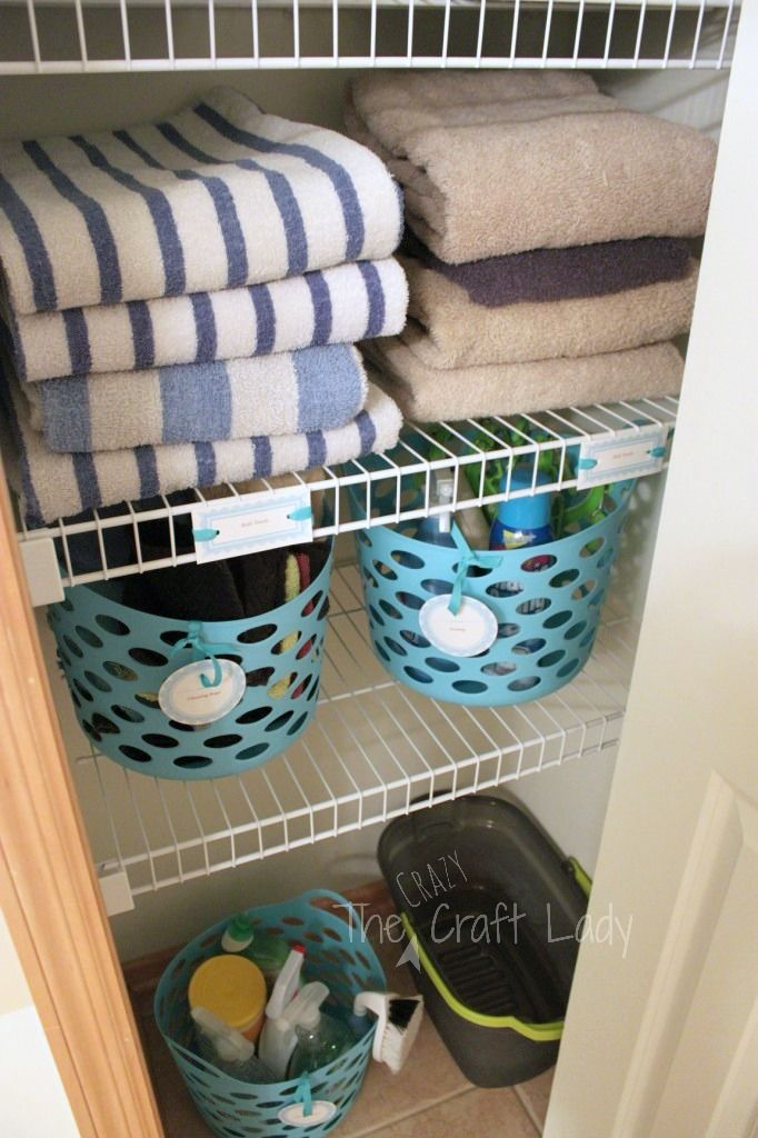cleaning supplies in tub @ bottom of closet |Dollar Store Bathroom Organizing