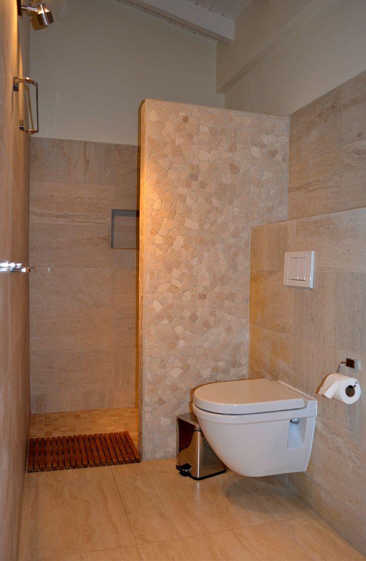 All natural stone tiled bathroom.