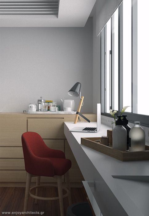 the corian sink countertop, also stands for a cosy desk in this small hotel room by enjoy architects