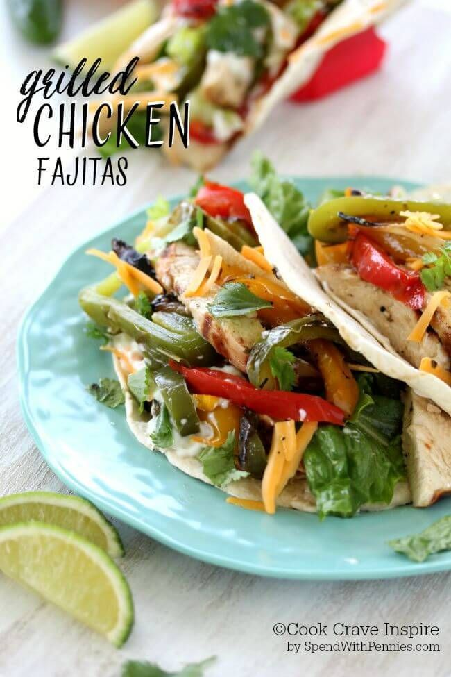 Grilled Chicken Fajitas! A homemade fajita marinade makes deliciously tender chicken! These are serve with grilled peppers & onions and loaded with your favorite toppings for a quick, healthy meal!