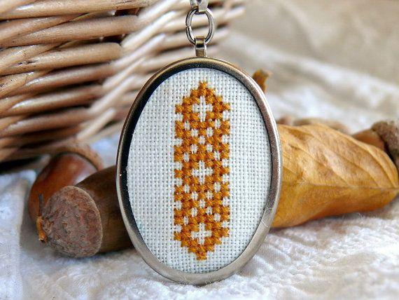 Small border motif pendant.