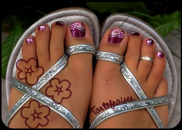 Love this polish on her toes!  Cute flowers on the big toes with just bands of silver on the others.