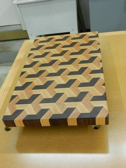 another Optical Illusion: Woodworking for Mere Mortals:: Make an end-grain cutting board.  I love the pattern on this.