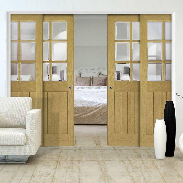 Deanta Quad Telescopic Pocket Ely Oak Veneer Doors   Clear Bevelled Safety  Glass   Unfinished