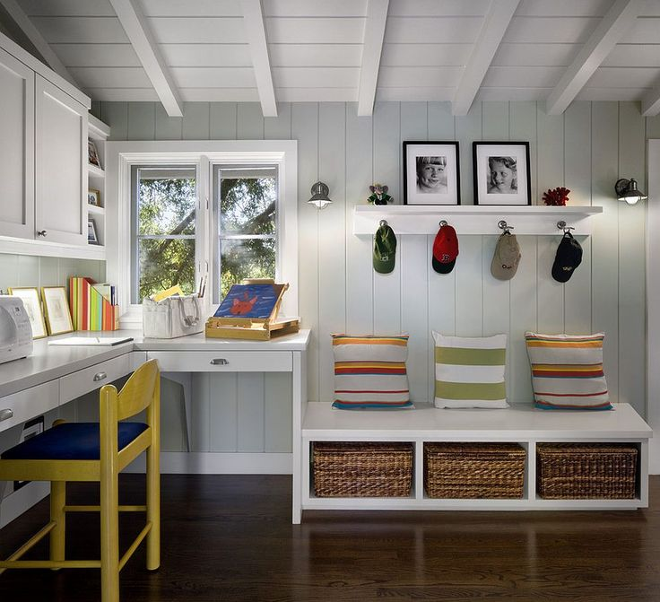 Bright pops of color in the mudroom seem even more attractive thanks to the gray backdrop 10 Versatile Mudrooms That Double as Home Workspaces